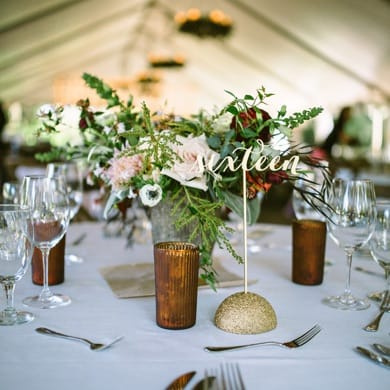 table centerpiece at wedding reception set inside a marquee